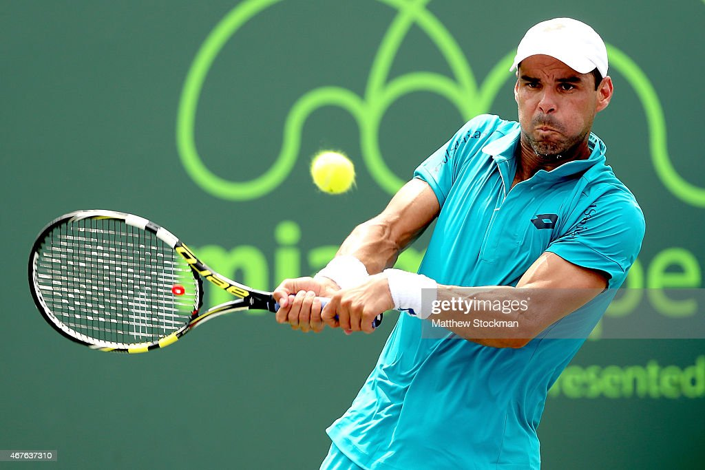 <a gi-track='captionPersonalityLinkClicked' href=/galleries/search?phrase=Alejandro+Falla&family=editorial&specificpeople=553827 ng-click='$event.stopPropagation()'>Alejandro Falla</a> of Colombia returns a shot to Michael Berrer of Germany during day 4 of the Miami Open Presented by Itau at Crandon Park Tennis Center on March 26, 2015 in Key Biscayne, Florida.