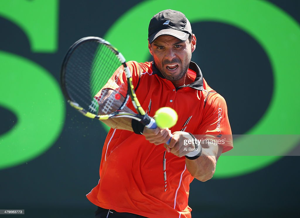 <a gi-track='captionPersonalityLinkClicked' href=/galleries/search?phrase=Alejandro+Falla&family=editorial&specificpeople=553827 ng-click='$event.stopPropagation()'>Alejandro Falla</a> of Columbia returns the ball to Marinko Matosevic of Australia on day 3 of the Sony Open at Crandon Park Tennis Center on March 19, 2014 in Key Biscayne, Florida.