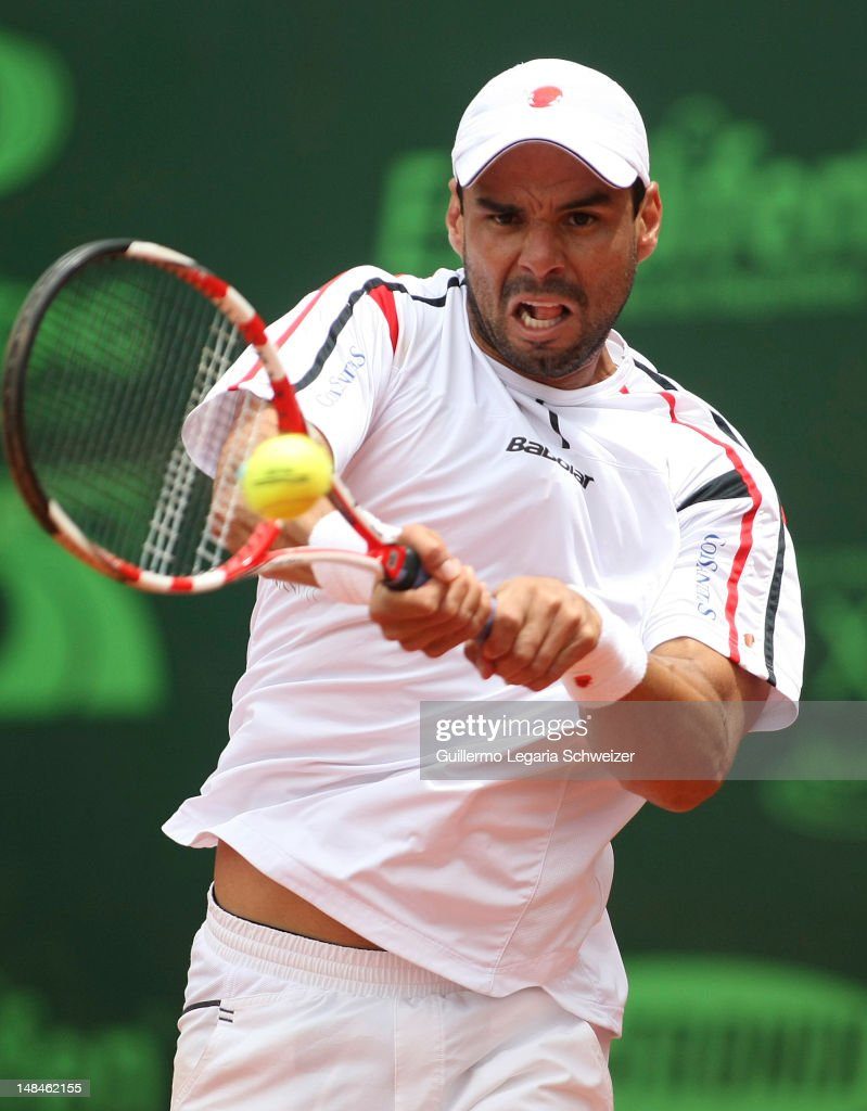 <a gi-track='captionPersonalityLinkClicked' href=/galleries/search?phrase=Alejandro+Falla&family=editorial&specificpeople=553827 ng-click='$event.stopPropagation()'>Alejandro Falla</a> returns a shot during a match against Santiago Giraldo for the Final of the Seguros Bolivar Open Tournament at Club El Rancho on June 16, 2012 in Bogota, Colombia.