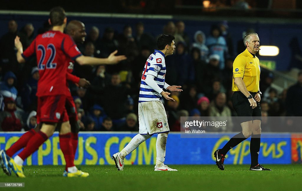 Alejandro Faurlin of Queens Park Rangers appeals to match referee <a gi-track='captionPersonalityLinkClicked' href=/galleries/search?phrase=Chris+Foy+-+Referee&family=editorial&specificpeople=696483 ng-click='$event.stopPropagation()'>Chris Foy</a> during the Barclays Premier League match between Queens Park Rangers and West Bromwich Albion at Loftus Road on December 26, 2012 in London, England.