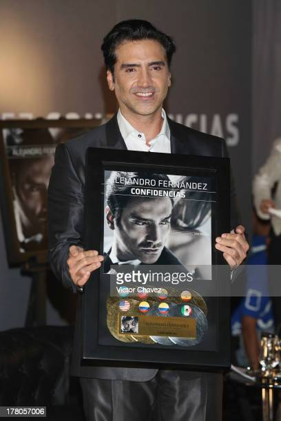 Alejandro Fernandez receives platinum and gold disc for more than 500000 copies sold in Latin America from his new album 'Confidencias' at Museo Jose...