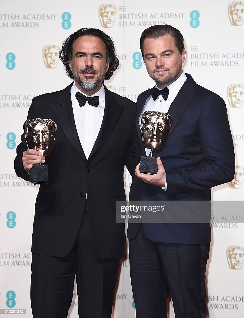 Alejandro G. Iñárritu, winner of Best Director for 'The Revenant' and Leonardo Dicaprio, winner of Best Actor for 'The Revenant' pose in the winners room at the EE British Academy Film Awards at the Royal Opera House on February 14, 2016 in London, England.