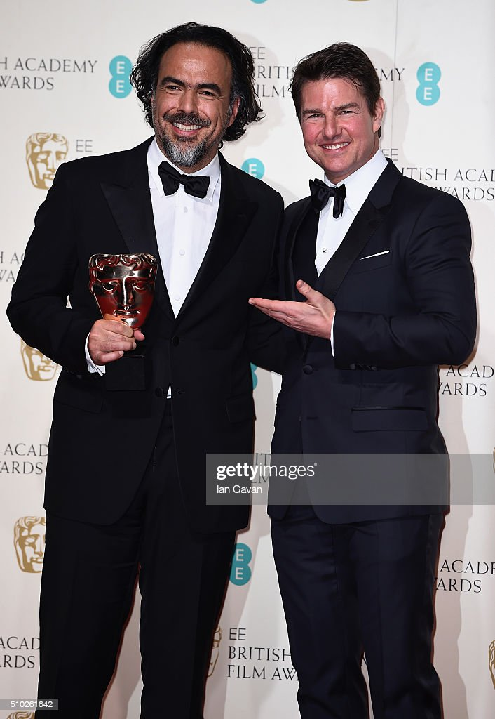 Alejandro G. Iñárritu, winner of Best Director for 'The Revenant' and <a gi-track='captionPersonalityLinkClicked' href=/galleries/search?phrase=Tom+Cruise&family=editorial&specificpeople=156405 ng-click='$event.stopPropagation()'>Tom Cruise</a> pose in the winners room at the EE British Academy Film Awards at the Royal Opera House on February 14, 2016 in London, England.