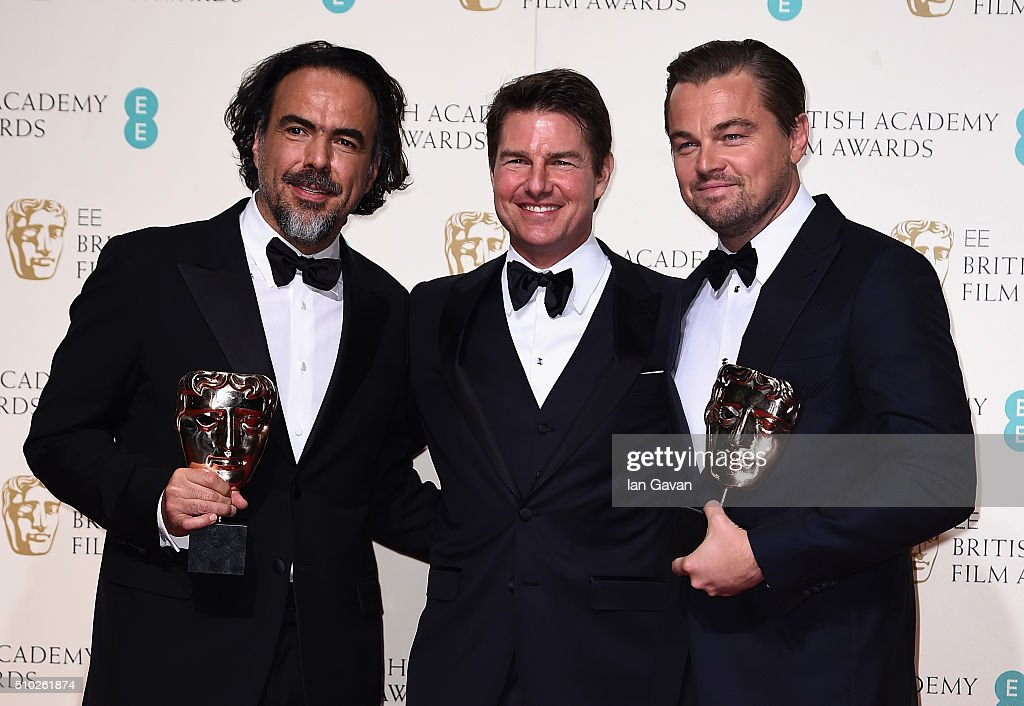 Alejandro G. Iñárritu, winner of Best Director for 'The Revenant', <a gi-track='captionPersonalityLinkClicked' href=/galleries/search?phrase=Tom+Cruise&family=editorial&specificpeople=156405 ng-click='$event.stopPropagation()'>Tom Cruise</a> and Leonardo Dicaprio, winner of Best Actor for 'The Revenant' pose in the winners room at the EE British Academy Film Awards at the Royal Opera House on February 14, 2016 in London, England.