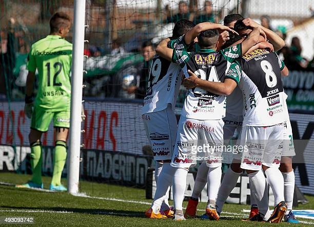 Alejandro Gagliardi of Nueva Chicago celebrates with teammates after scoring his team's third goal during a match between Nueva Chicago and Newell's...