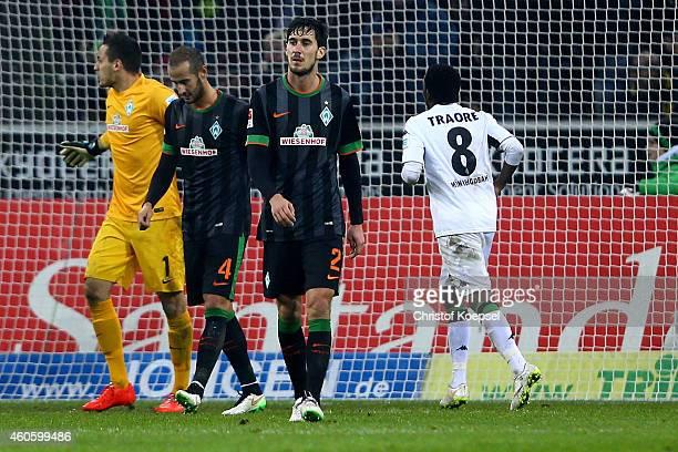 Alejandro Galvez and Santiago Garcia of Bremen look dejected after the second goal of Moenchengladbach during the Bundesliga match between Borussia...