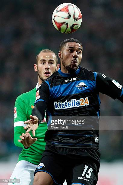 Alejandro Galvez of Bremen and Elias Kachunga of Paderborn compete for the ball during the First Bundesliga match between SV Werder Bremen and SC...