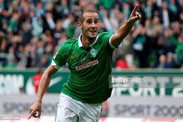 Alejandro Galvez of Bremen celebrates after scoring his team's first goal during the Bundesliga match between Werder Bremen and 1899 Hoffenheim at...