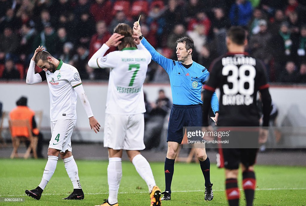 Alejandro Galvez of Werder Bremen reacts as he is shown a yellow card by referee <a gi-track='captionPersonalityLinkClicked' href=/galleries/search?phrase=Wolfgang+Stark&family=editorial&specificpeople=587593 ng-click='$event.stopPropagation()'>Wolfgang Stark</a> during the DFB Cup Quarter Final match between Bayer Leverkusen and Werder Bremen at BayArena on February 9, 2016 in Leverkusen, Germany.