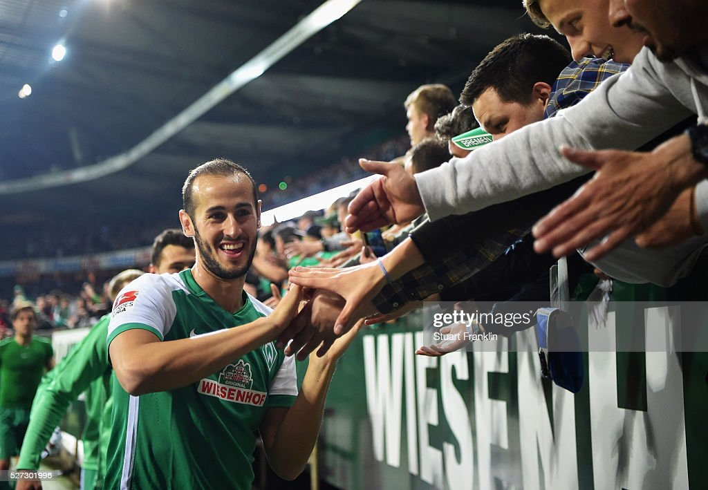 Alejandro Galvez of Werder Bremen shakes hands with fans after a 6:2 victory in the Bundesliga match between Werder Bremen and VfB Stuttgart at Weserstadion on May 2, 2016 in Bremen, Germany.