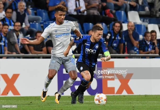 Alejandro Gómez of Atalanta competes for the ball whit Mason Holgate of Everton Fc during the UEFA Europa League group E match between Atalanta and...