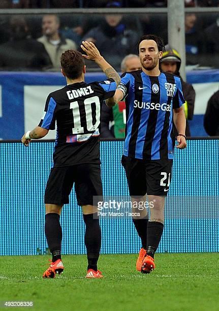 Alejandro Gomez and Cigarini Luca of Atalanta BC celebrate his third goal during the Serie A match between Atalanta BC and Carpi FC at Stadio Atleti...