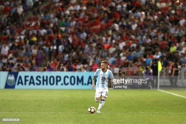 Alejandro Gomez of Argentina dribbles the ball during the international friendly match between Argentina and Singapore at National Stadium on June 13...