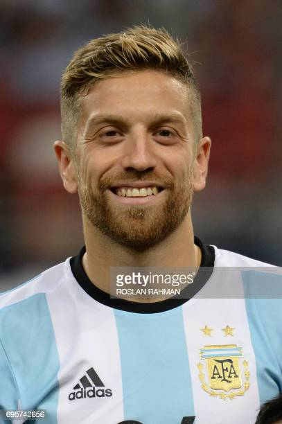 Alejandro Gomez of Argentina poses before the start of their international friendly football match against Singapore at the National Stadium in...