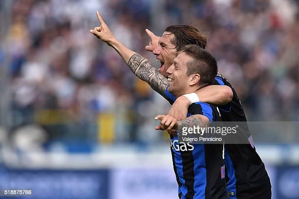 Alejandro Gomez of Atalanta BC celebrates a goal with team mate Guglielmo Stendardo during the Serie A match between Atalanta BC and AC Milan at...