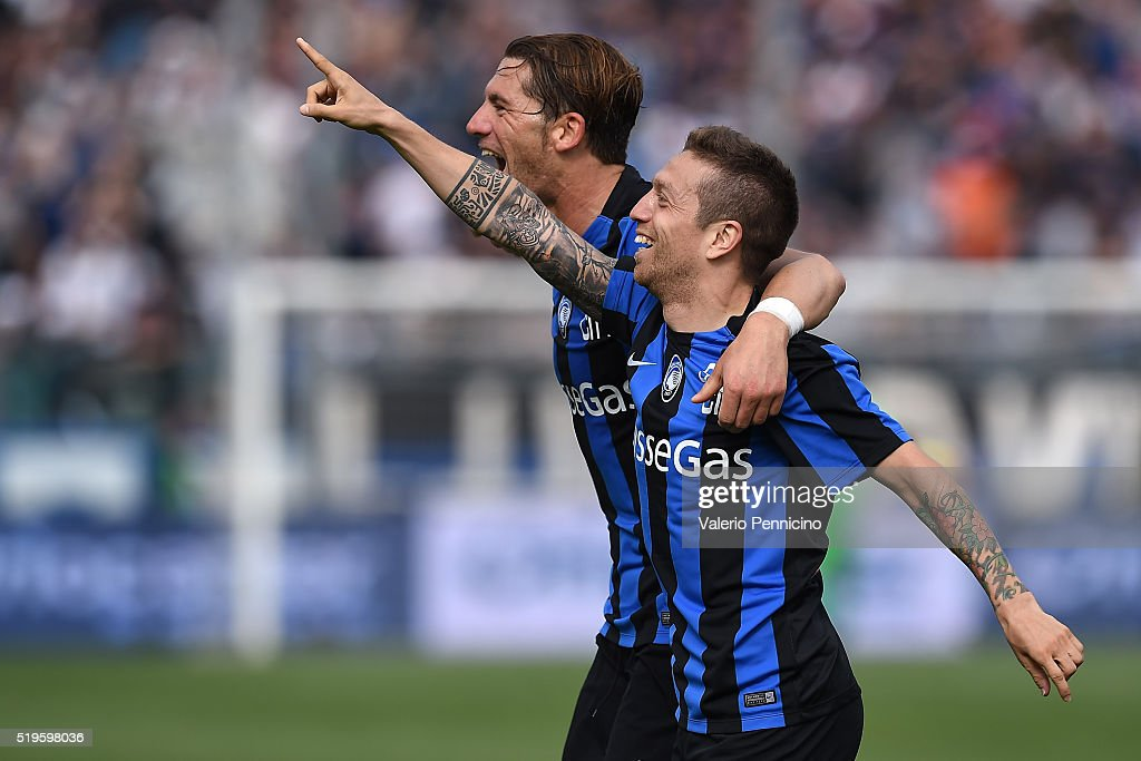 Alejandro Gomez (R) of Atalanta BC celebrates a goal with team mate Guglielmo Stendardo during the Serie A match between Atalanta BC and AC Milan at Stadio Atleti Azzurri d'Italia on April 3, 2016 in Bergamo, Italy.