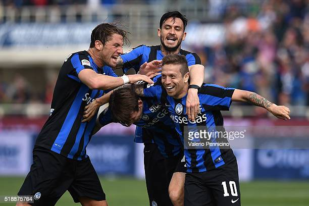 Alejandro Gomez of Atalanta BC celebrates a goal with team mates Mauricio Pinilla and Guglielmo Stendardo during the Serie A match between Atalanta...