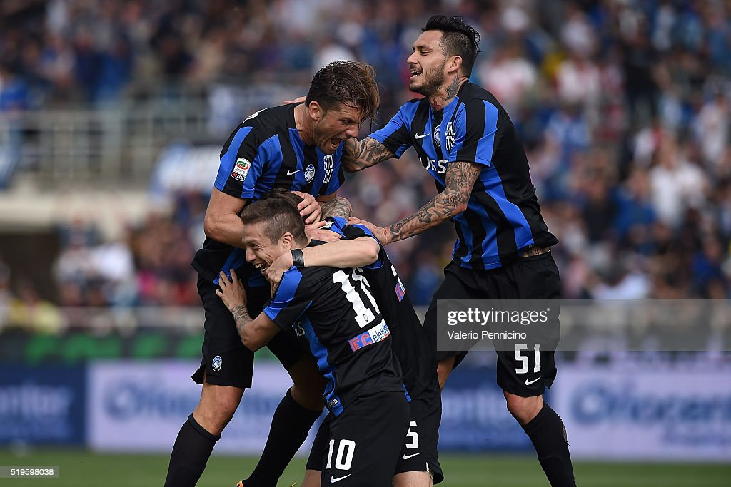 Alejandro Gomez (L) of Atalanta BC celebrates a goal with team mates <a gi-track='captionPersonalityLinkClicked' href=/galleries/search?phrase=Mauricio+Pinilla&family=editorial&specificpeople=2133009 ng-click='$event.stopPropagation()'>Mauricio Pinilla</a> (R) and Guglielmo Stendardo (C) during the Serie A match between Atalanta BC and AC Milan at Stadio Atleti Azzurri d'Italia on April 3, 2016 in Bergamo, Italy.