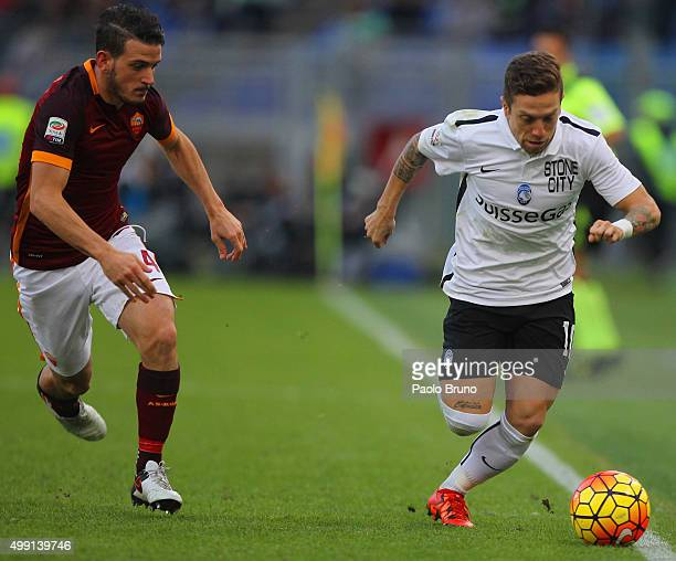Alejandro Gomez of Atalanta BC competes for the ball with Alessandro Florenzi of AS Roma during the Serie A match between AS Roma and Atalanta BC at...