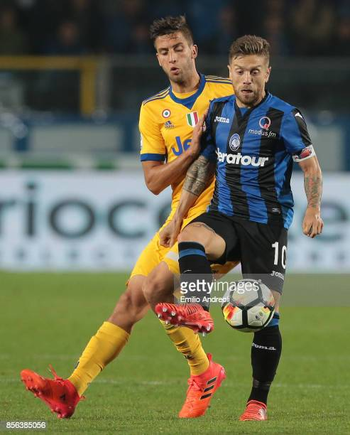 Alejandro Gomez of Atalanta BC competes for the ball with Rodrigo Bentancur of Juventus FC during the Serie A match between Atalanta BC and Juventus...
