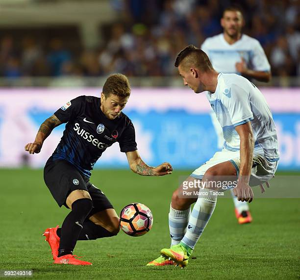 Alejandro Gomez of Atalanta BC competes for the ball with Sergej Milinkovic of SS Lazio during the Serie A match between Atalanta BC and SS Lazio at...