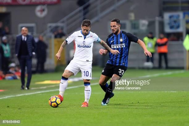 Alejandro Gomez of Atalanta Bergamasca Calcio and Danilo D'ambrosio of Fc Internazionale in action during the Serie A match between FC Internazionale...