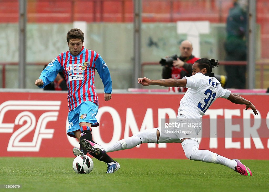 Alejandro Gomez (L) of Calcio Catania competes for the ball with Alvaro Pereira of FC Internazionale during the Serie A match between Calcio Catania and FC Internazionale Milano at Stadio Angelo Massimino on March 3, 2013 in Catania, Italy.