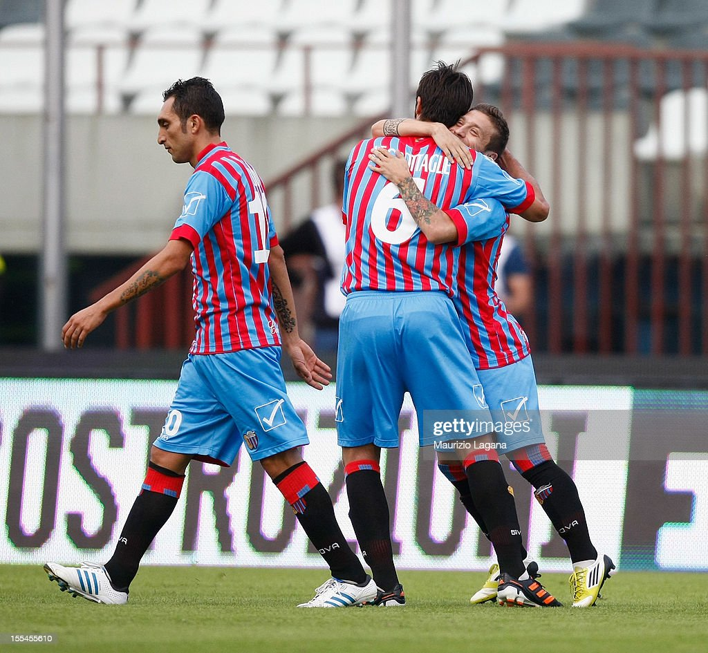 Alejandro Gomez (R) of Catania celebrates afer scoring the opening goal during the Serie A match between Calcio Catania and S.S. Lazio at Stadio Angelo Massimino on November 4, 2012 in Catania, Italy.