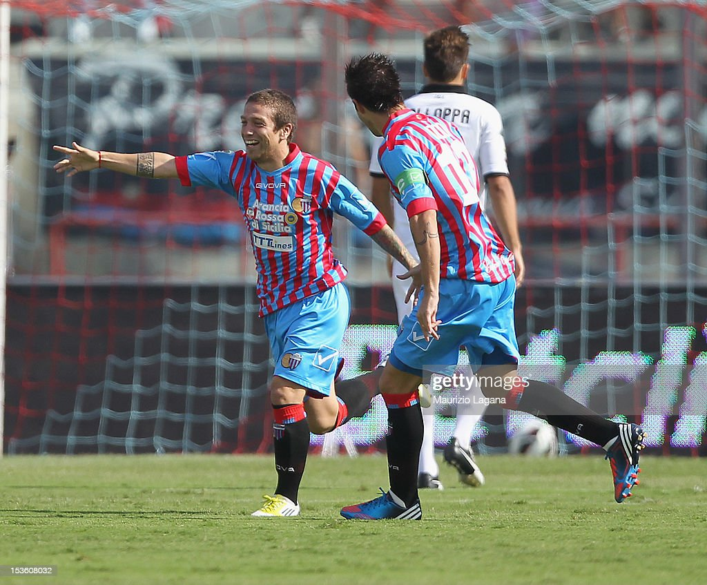 Alejandro Gomez (L) of Catania celebrates the opening goal during the Serie A match between Calcio Catania and Parma FC at Stadio Angelo Massimino on October 7, 2012 in Catania, Italy.