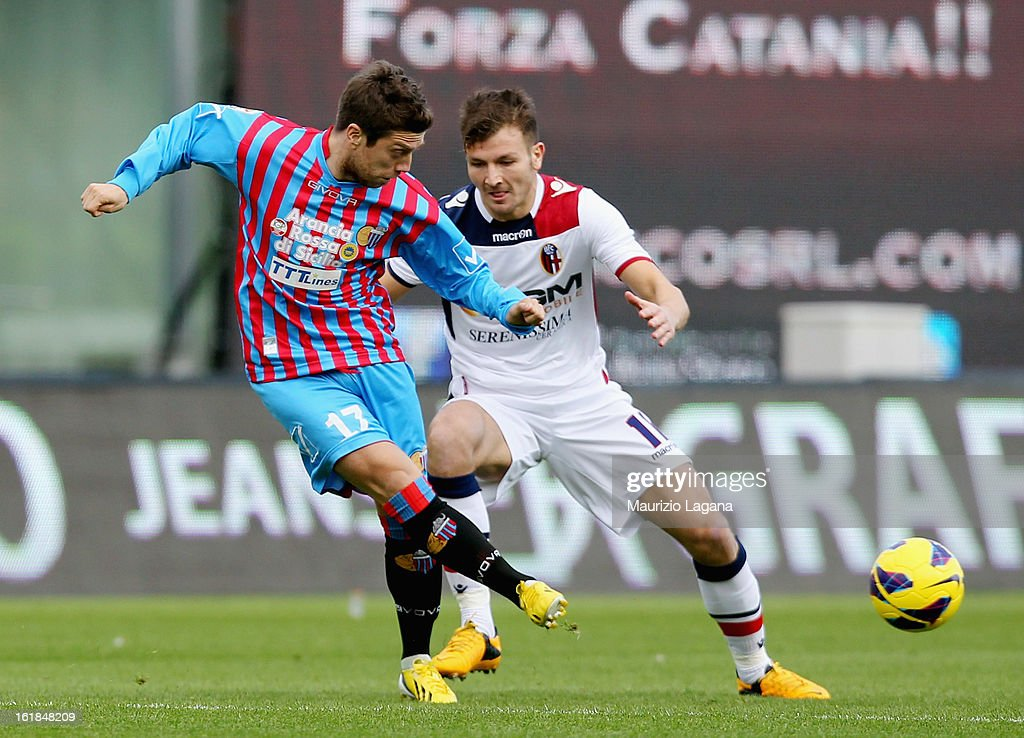 Alejandro Gomez (L) of Catania competes for the ball with Marco Motta of Bologna during the Serie A match between Calcio Catania and Bologna FC at Stadio Angelo Massimino on February 17, 2013 in Catania, Italy.