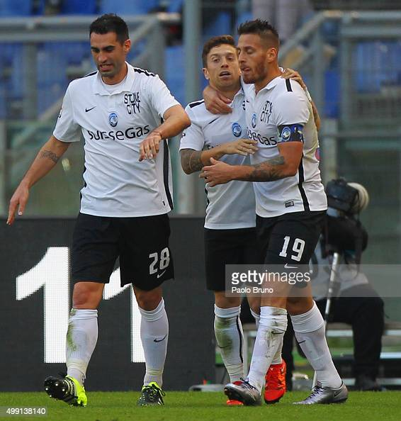 Alejandro Gomez with his teammates of Atalanta BC celebrates after scoring the opening goal during the Serie A match between AS Roma and Atalanta BC...