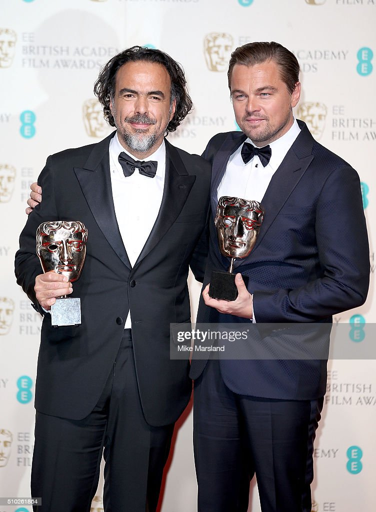 Alejandro Gonzalez Inarritu, winner of the Best Director award for 'The Revenant' (L) and <a gi-track='captionPersonalityLinkClicked' href=/galleries/search?phrase=Leonardo+DiCaprio&family=editorial&specificpeople=201635 ng-click='$event.stopPropagation()'>Leonardo DiCaprio</a>, winner of the Best Actor award for 'The Revenant', pose in the winners room at the EE British Academy Film Awards at The Royal Opera House on February 14, 2016 in London, England.
