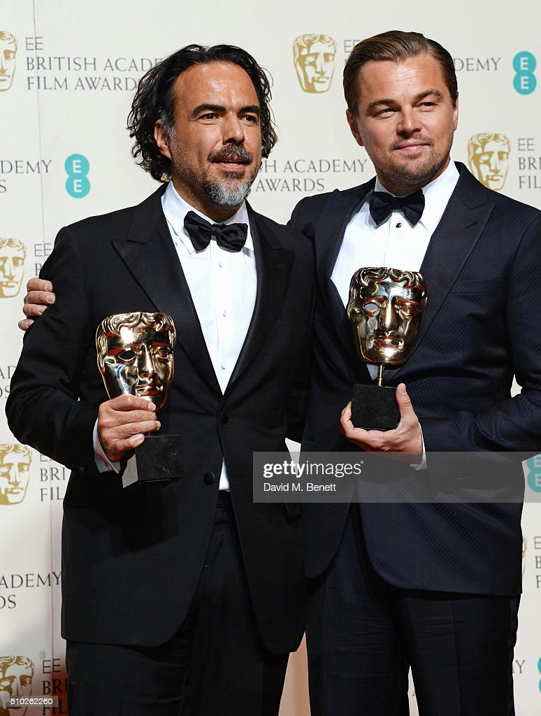 Alejandro Gonzalez Inarritu, winner of the Best Director award for 'The Revenant' (L) and Leonardo DiCaprio, winner of the Best Actor award for 'The Revenant', pose in the winners room at the EE British Academy Film Awards at The Royal Opera House on February 14, 2016 in London, England.
