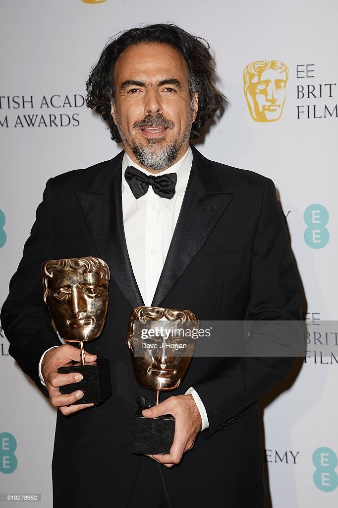 Alejandro Gonzalez Inarritu, with his two BAFTA Awards, attends the official After Party Dinner for the EE British Academy Film Awards at The Grosvenor House Hotel on February 14, 2016 in London, England.