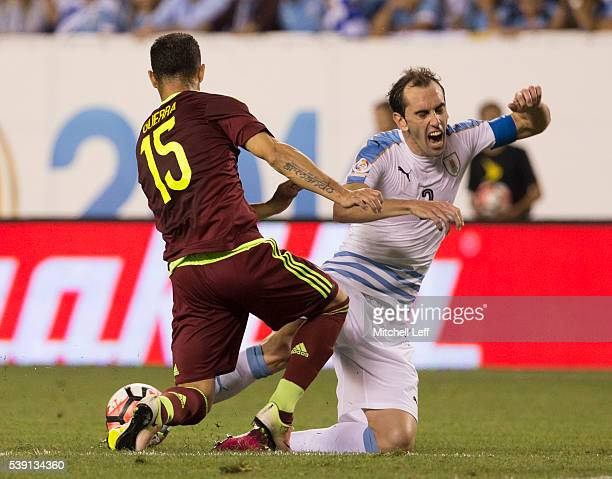 Alejandro Guerra of Venezuela steals the ball from Diego Godin of Uruguay during the 2016 Copa America Centenario Group C match at Lincoln Financial...