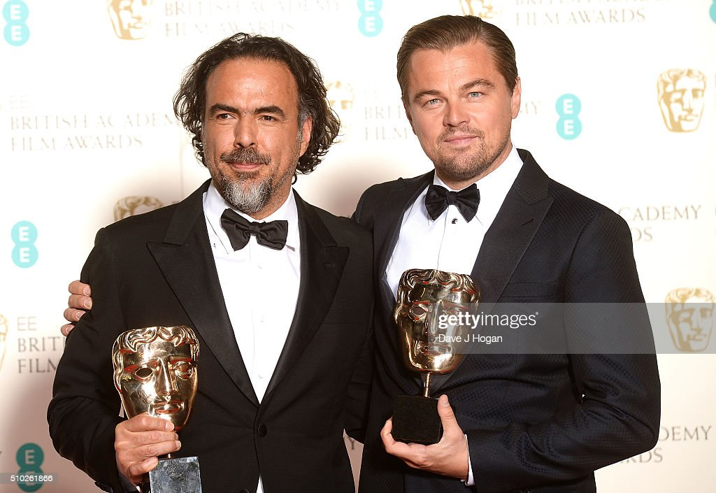 Alejandro Inarritu (L) and <a gi-track='captionPersonalityLinkClicked' href=/galleries/search?phrase=Leonardo+DiCaprio&family=editorial&specificpeople=201635 ng-click='$event.stopPropagation()'>Leonardo DiCaprio</a> pose in the winners room with their awards for Lead Actor and Best Film at the EE British Academy Film Awards at The Royal Opera House on February 14, 2016 in London, England.