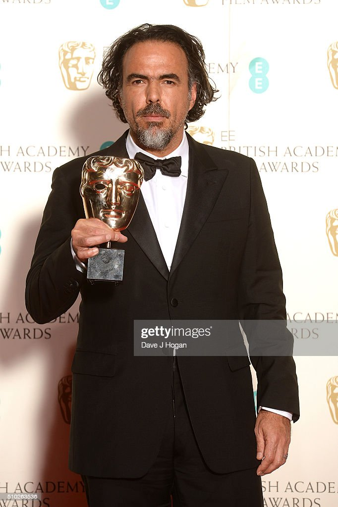 Alejandro Inarritu hold the award for Best Film in the winners room at the EE British Academy Film Awards at The Royal Opera House on February 14, 2016 in London, England.
