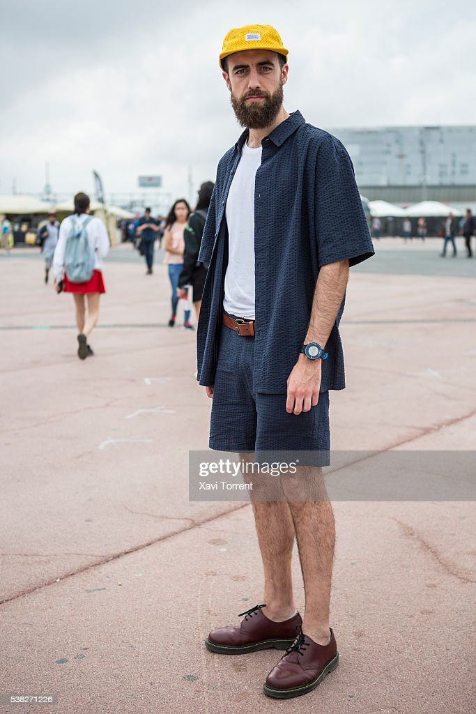 Alejandro is wearing HM tshirt APDT pants and shirt Dr Martens shoes and Norse Projects cap during Primavera Sound 2016 in Barcelona Spain