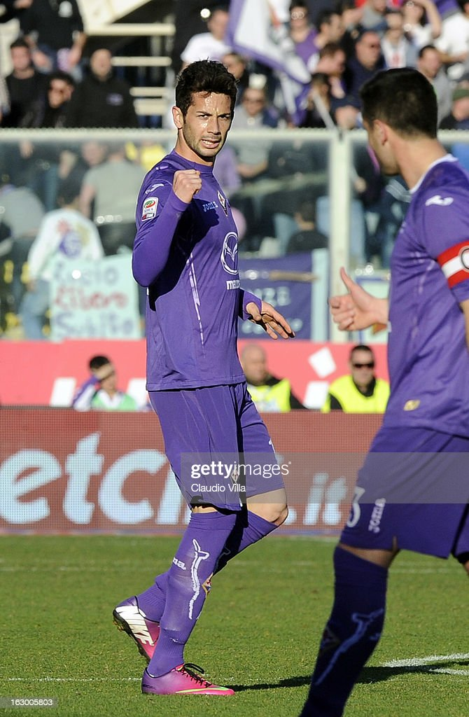Alejandro Larrondo (L) of ACF Fiorentina celebrates scoring the second goal during the Serie A match between ACF Fiorentina and AC Chievo Verona at Stadio Artemio Franchi on March 3, 2013 in Florence, Italy.