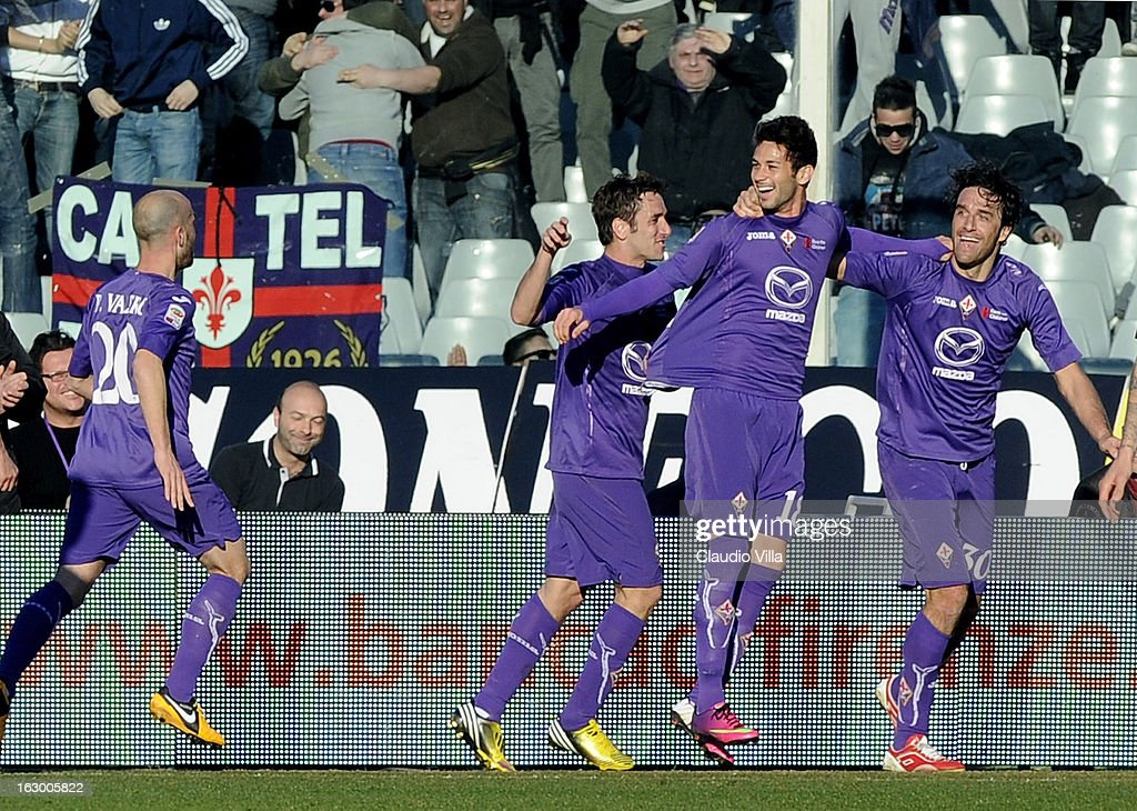 Alejandro Larrondo of ACF Fiorentina (2nd R) celebrates scoring the second goal during the Serie A match between ACF Fiorentina and AC Chievo Verona at Stadio Artemio Franchi on March 3, 2013 in Florence, Italy.