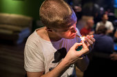 Alejandro lights a marijuana joint in a cannabis club on August 22 2014 in Barcelona Spain Under Spanish law marijuana can be consumed and grown for...