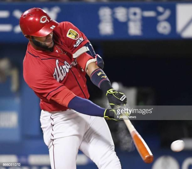 Alejandro Mejia of the Hiroshima Carp hits a runscoring single in the second inning against the DeNA BayStars at Yokohama Stadium on Sept 30 2017...