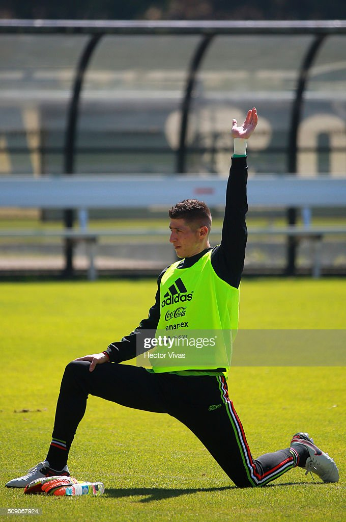 Alejandro Palacios stretches during a Mexico training session at Centro de Alto Rendimiento on February 08, 2016 in Mexico City, Mexico. Mexico will face Senegal on February 10, 2016. (Photo by Hector Vivas/LatinContent