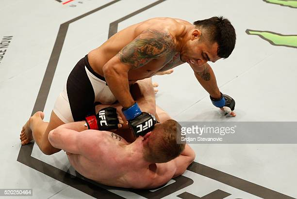 Alejandro Perez punches Ian Entwistle in their bantamweight bout during the UFC Fight Night event at the Arena Zagreb on April 10 2016 in Zagreb...