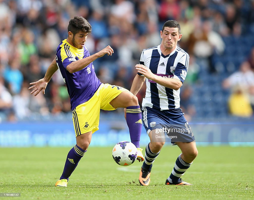 Alejandro Pozuelo of Swansea City is challenged by Graham Dorrans during the Barclays Premier League match between West Bromwich Albion and Swansea City at The Hawthorns on September 01, 2013 in West Bromwich, England.