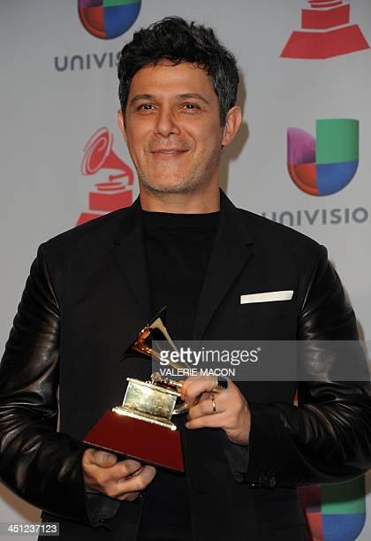 Alejandro Sanz winner of the Best Contemporary Pop Vocal Album for 'La Música No Se Toca' poses in the press room during the 14th annual Latin Grammy...
