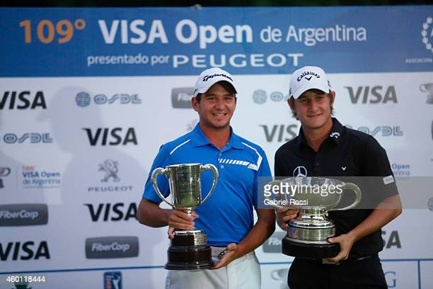 Alejandro Tosti and Emiliano Grillo of Argentina celebrate with their trophies during the closing day of the 109th VISA Open Argentina as part of PGA...
