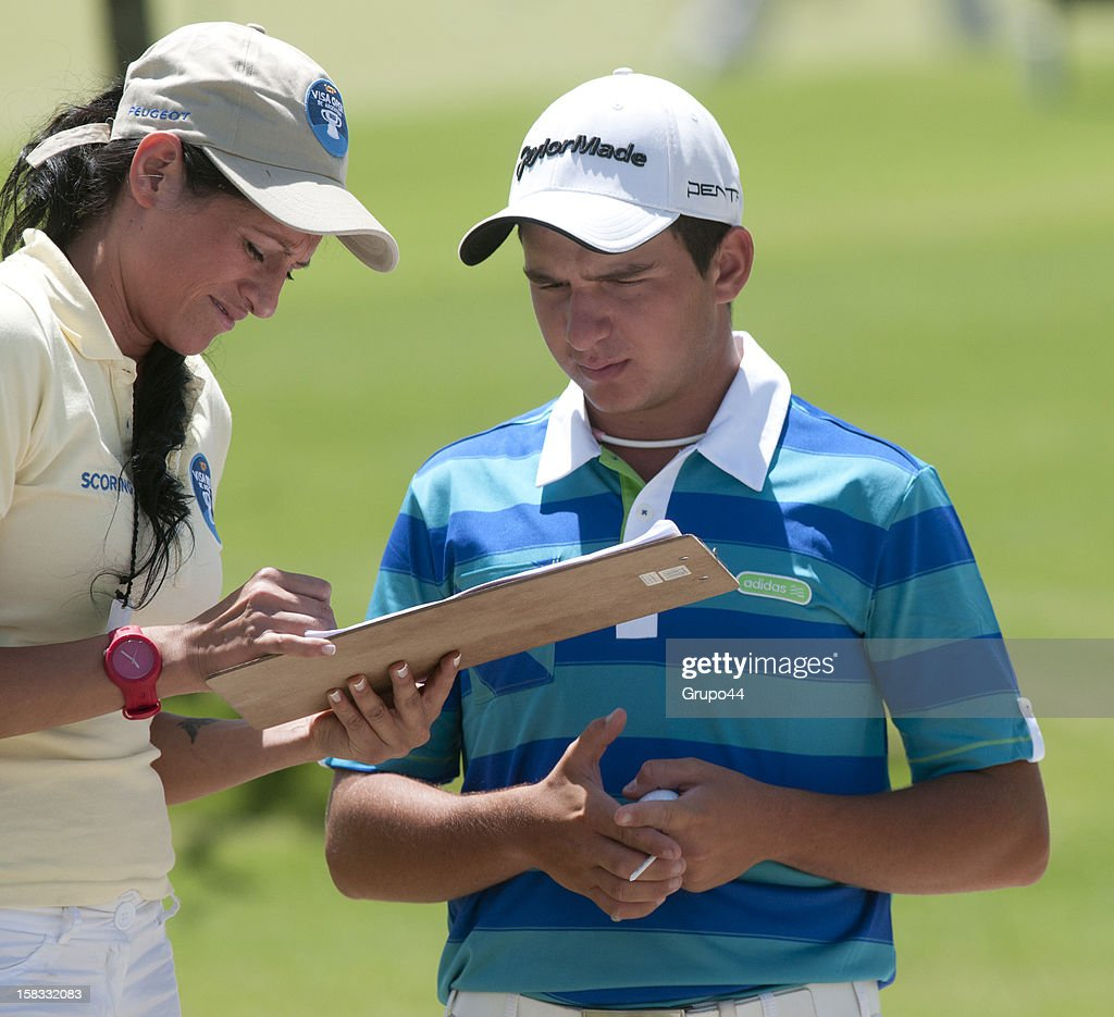 Alejandro Tosti of Argentina checks his results during the opening day of the 107 Visa Golf Open presented by Peugeot as part of the PGA Latin America at Nordelta Golf Club on December 13, 2012 in Buenos Aires, Argentina.