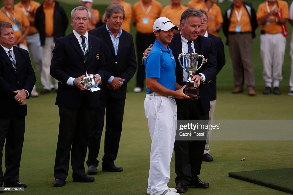 Alejandro Tosti of Argentina receives the Pereyra Iraola Cup trophy after the closing day of the 109th VISA Open Argentina as part of PGA Latinoamerica tour at Martindale Country Club on December 07, 2014 in Buenos Aires, Argentina.