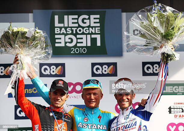 Alejandro Valverde of Spain and Caisse D'Epargne Alexandre Vinokourov of Kazakhstan and Astana and Alexandr Kolobnev of Russia and Team Katusha stand...